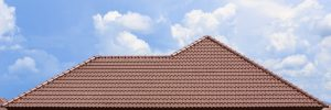roof under construction with stacks of roof tiles for home building